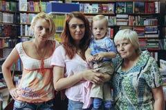 Three generations of women. LUTSK, UKRAINE - 27 August: Three generations of women in the bookstore Royalty Free Stock Photos