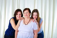 Three generations of women together Stock Photo