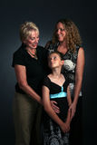 Three generations of women together. Studio portrait of three generations of women Royalty Free Stock Photography