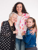 Three generations of women. On a white background Royalty Free Stock Images