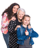 Three generations of women. On a white background Stock Photos
