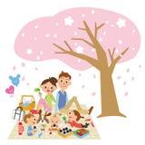 Three-generytion家庭是樱桃开花观察 免版税库存照片