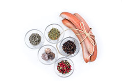 Three german sausage and spice that were used to prepare them Royalty Free Stock Images