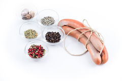 Three german sausage and spice that were used to prepare them. Three raw german sausage and spice that were used to prepare them Royalty Free Stock Image