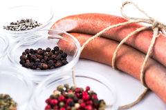 Three german sausage and spice that were used to prepare them. Three raw german sausage and spice that were used to prepare them Royalty Free Stock Photo