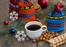 Three gift bags, fir-tree branch, coffee and nutlets Royalty Free Stock Photo