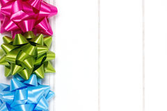 Three gift bows piled Royalty Free Stock Images