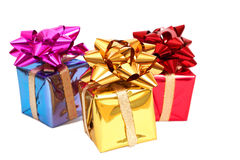 Three gift boxes with a bows. Three gift boxes with bows for Christmas or Valentines Day on white background Royalty Free Stock Photography