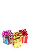 Three gift boxes with bows. Three colorful gift boxes with bows for Christmas or Valentines Day isolated on white background Stock Photo