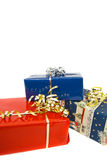 Three gift-boxes isolated. Photo of three gift-boxes decorated with ribbons, isolated on white background Stock Photo