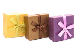 Three gift boxes with ribbon isolated Stock Photos