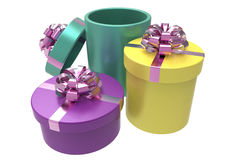Three gift boxes with shiny red bowknots Royalty Free Stock Image