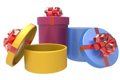 Three gift boxes with shiny red bowknots Royalty Free Stock Photography