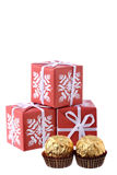 Three gift boxes and two luxury sweets isolated Royalty Free Stock Images