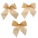 Three gift gold ribbon and bow Royalty Free Stock Photo