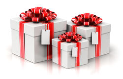 Three gift or present boxes with ribbon bows and label tags Stock Image