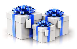 Three gift or present boxes with ribbon bows and label tags Stock Photography