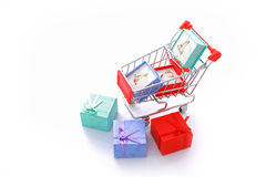 Three gift rings in shopping cart isolated Royalty Free Stock Photos