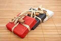 Three gifts on bamboo mat Stock Photos