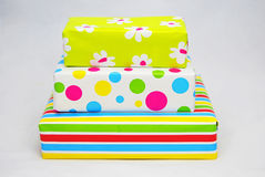 Three gifts  with colored paper Royalty Free Stock Photos