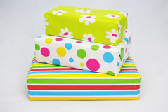 Three gifts  with colored paper Royalty Free Stock Photo