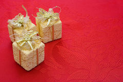 Three gifts on red background Royalty Free Stock Photography