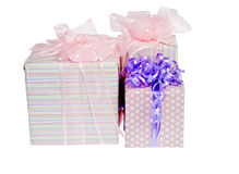 Three Gifts Wrapped with Colorful Ribbons Royalty Free Stock Photography