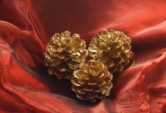 Three gilded pine cones Stock Images