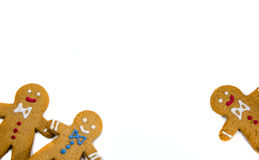 Three gingerbread cookie men looking out. Of the corners royalty free stock photography