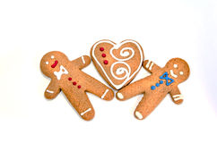 Three gingerbread cookie men. On white background royalty free stock image