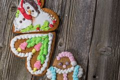 Three Gingerbread Cookies on old wood. En Table. Christmas Still Life Photo Royalty Free Stock Image