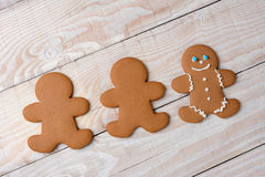 Three Gingerbread Cookies One Decorated Royalty Free Stock Photography