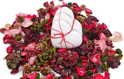 Three gingerbread hearts in the background of sachet petals. Over white Royalty Free Stock Image