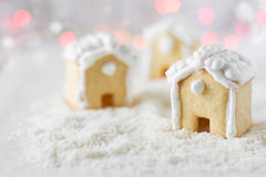 Three gingerbread houses on the background of bokeh and snow Royalty Free Stock Photo