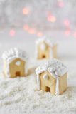 Three gingerbread houses on the background of bokeh and snow Royalty Free Stock Image