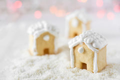 Three gingerbread houses on the background of bokeh and snow Stock Photo