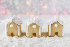 Three gingerbread houses on the background of bokeh and snow Royalty Free Stock Photos