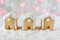 Three gingerbread houses on the background of bokeh and snow Stock Image