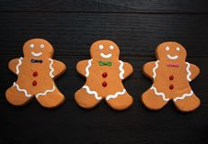 Three Gingerbread Men cookies on black royalty free stock images
