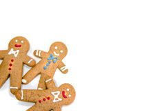 Three gingerbread men isolated in the corner. Three gingerbread men in the corner on white background royalty free stock image