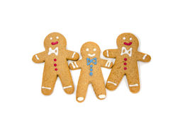 Three gingerbread men isolated. Three gingerbread men on white background stock photography