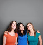 Three girl best friend looking up to blank space Royalty Free Stock Images