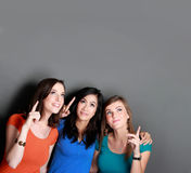 Three girl best friend looking up to blank space Royalty Free Stock Photos