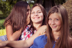 Three girl friends having fun on hay stack Royalty Free Stock Image