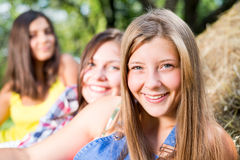 Three girl friends having fun on hay stack Royalty Free Stock Photography