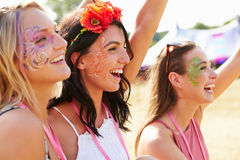Three girl friends at a music festival Stock Image