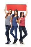 Three girl friends with red banner Royalty Free Stock Images