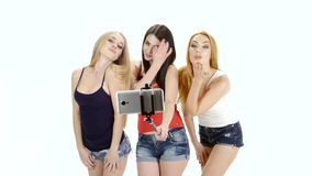 Three girl model pose for a selfie photo. White background stock video