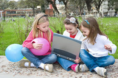 Three girl are playing in the park Stock Images