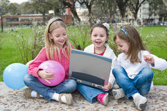 Three girl are playing in the park Royalty Free Stock Image